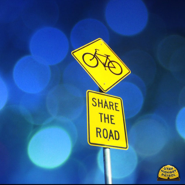 Road sign with bicycle and Share the Road logo
