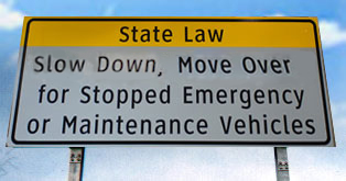 Slow down and move over for emergency vehicles freeway sign