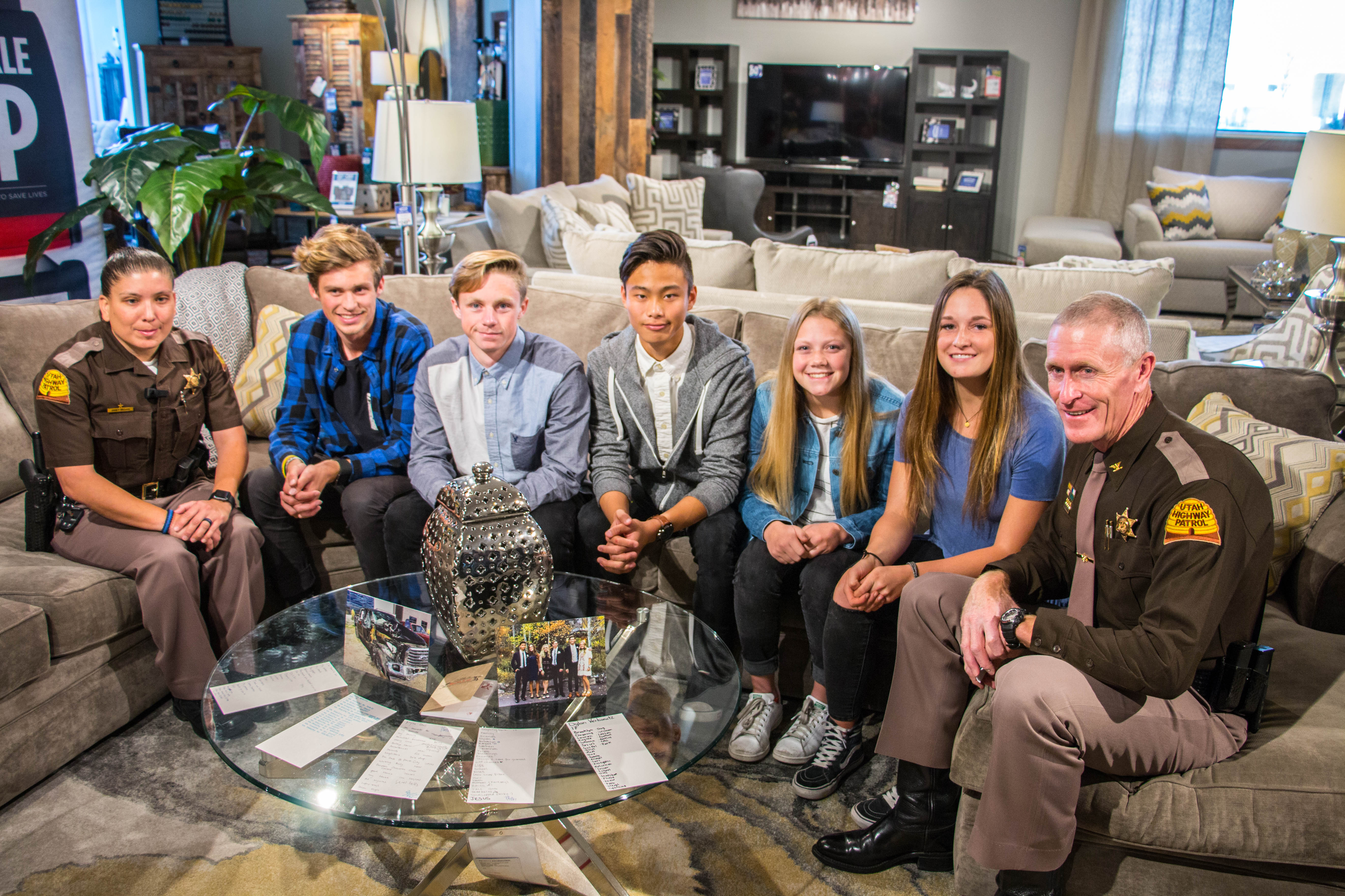 Trooper Janet Miller and Colonel Rapich sit with teens who survived crash because of seat belts